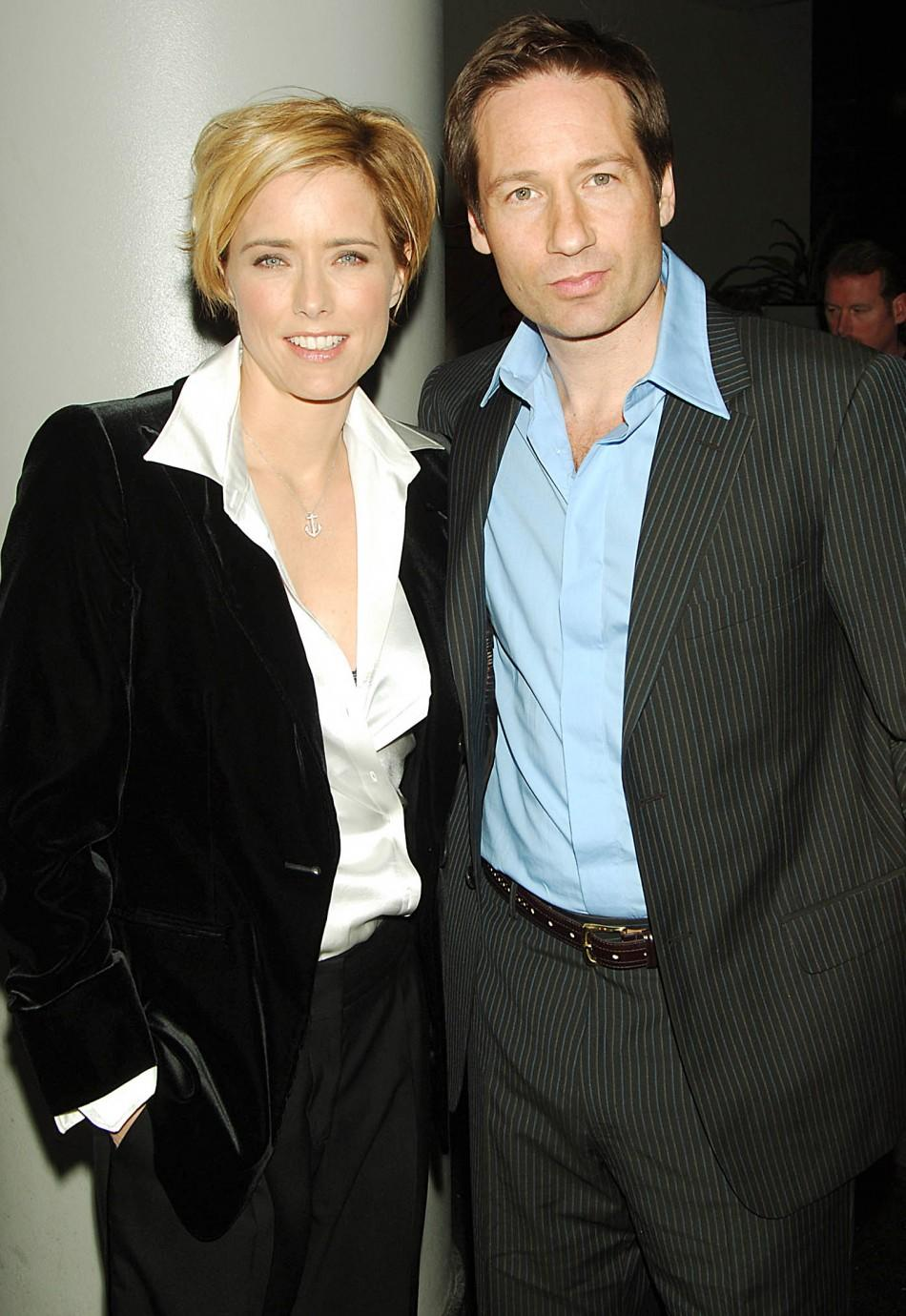 "Actors David Duchovny and Tea Leoni pose for photographers during the premiere of their film ""House of D"" in New York April 10, 2005."