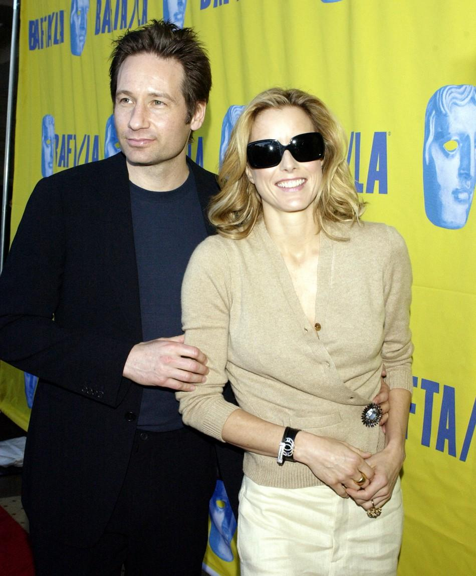 Actor David Duchovny (L) and his wife, actress Tea Leoni arrive for the 11th annual British Academy of Film and Television Arts Los Angeles Tea Party, honoring the 2004 Golden Globe nominees in Los Angeles, California Saturday, January 15, 2005.