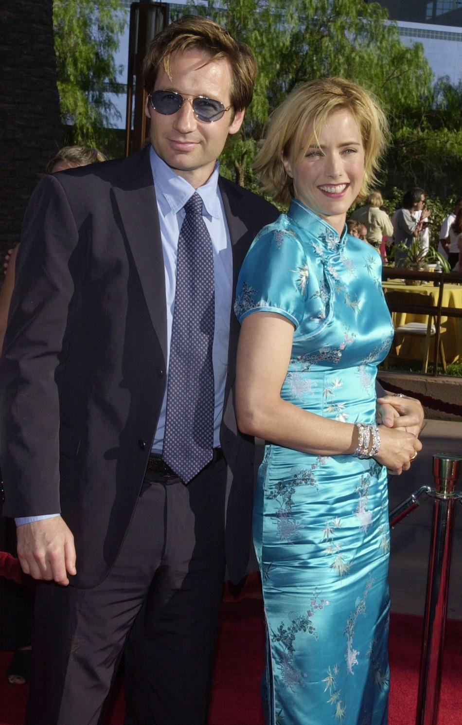"Actress Tea Leoni, who stars in the action adventure motion picture ""Jurassic Park III,"" arrives July 16, 2001 with her husband, actor David Duchovny, at the Los Angeles premiere of the film at the Universal Amphitheatre."