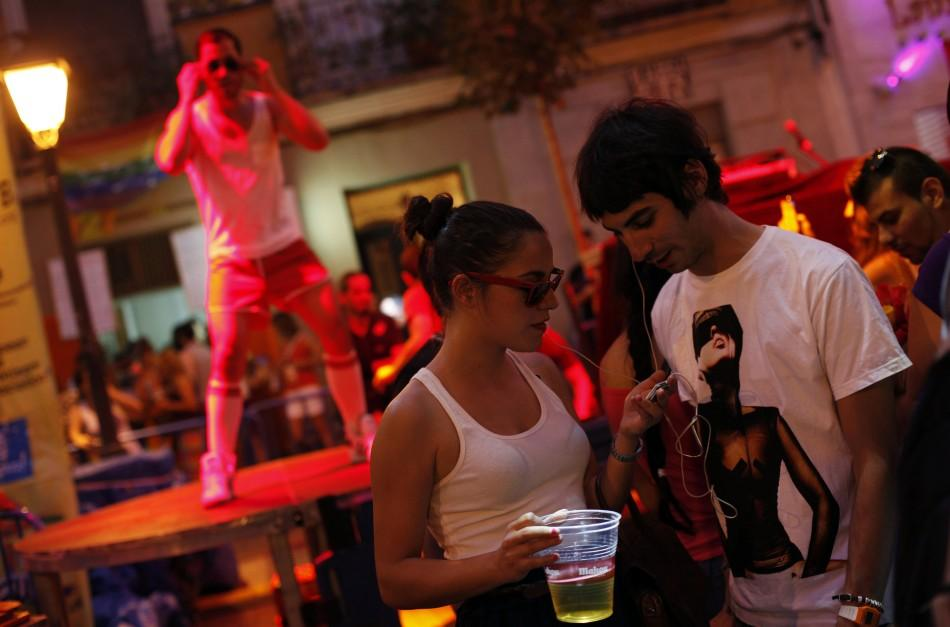 "People listen to music on earphones through their smartphone during the ""Silent Disco"", as part of Gay Pride celebrations in the quarter of Chueca in Madrid"