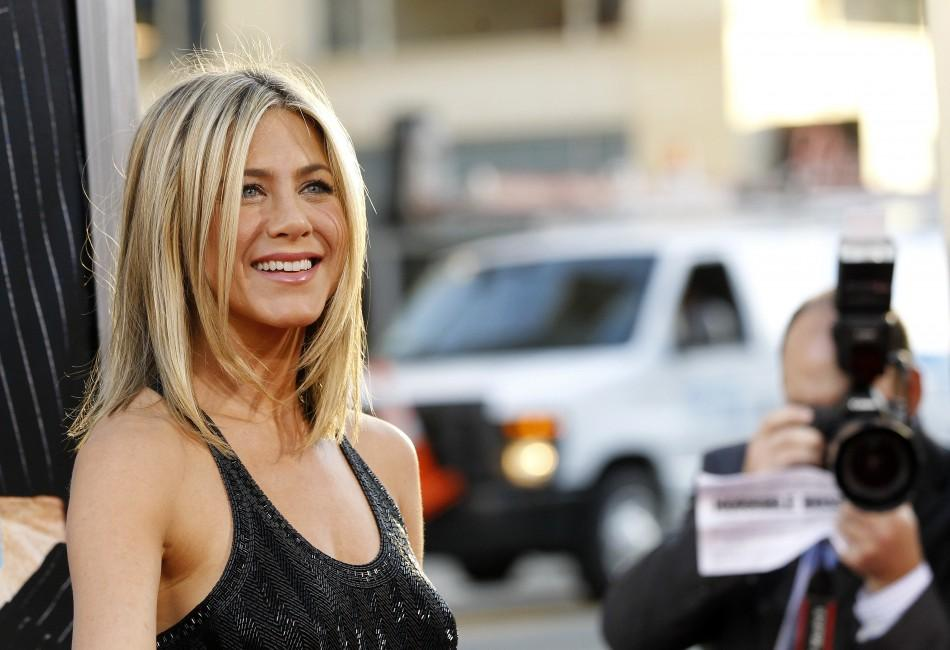 "Cast member Jennifer Aniston poses at the premiere of ""Horrible Bosses"" at the Grauman's Chinese theatre in Hollywood, California June 30, 2011."