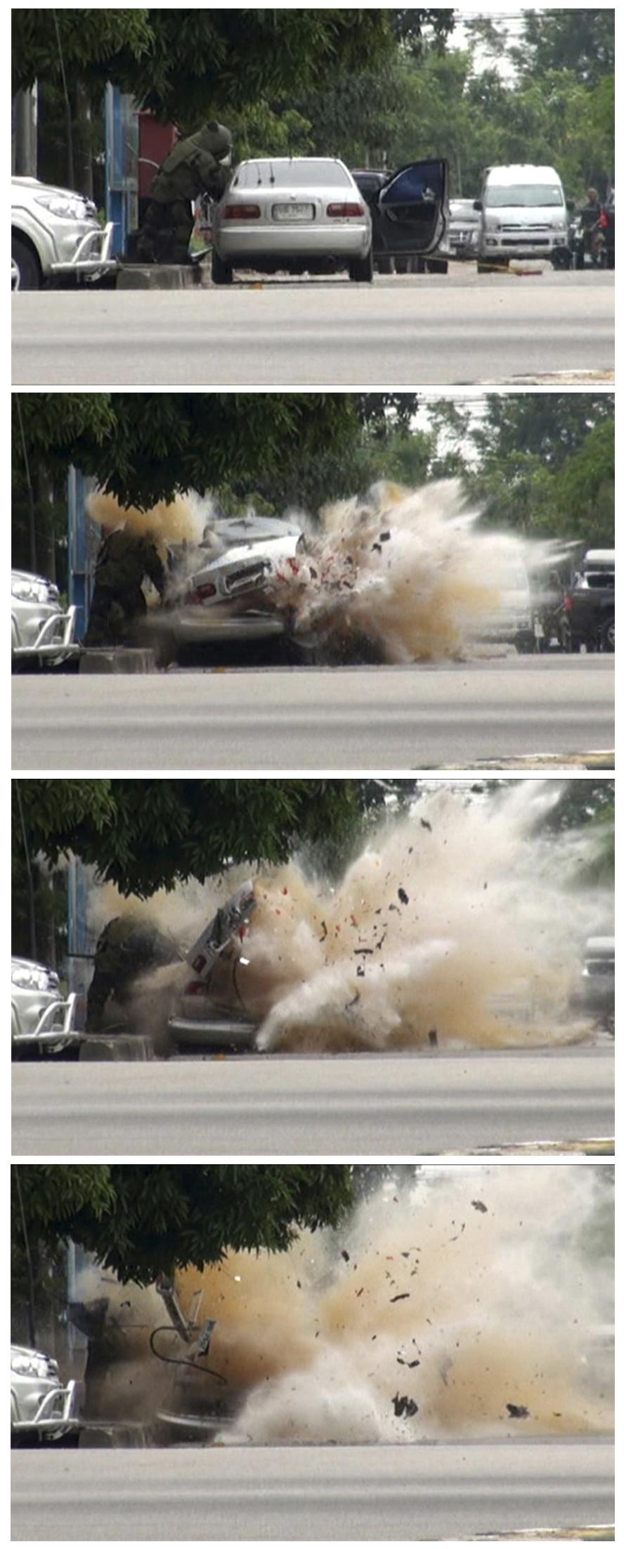 This combination photo shows a car bomb exploding as a member of a Thai bomb squad inspects it in Narathiwat province