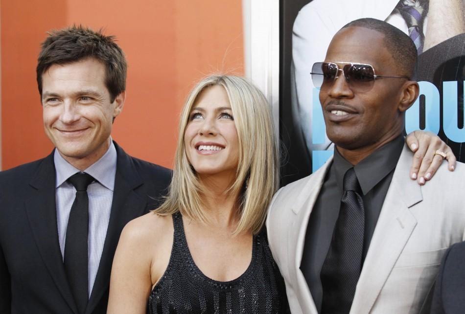Cast members Jason Bateman, Jennifer Aniston and Jamie Foxx pose at the premiere of Horrible Bosses at the Grauman's Chinese theatre in Hollywood