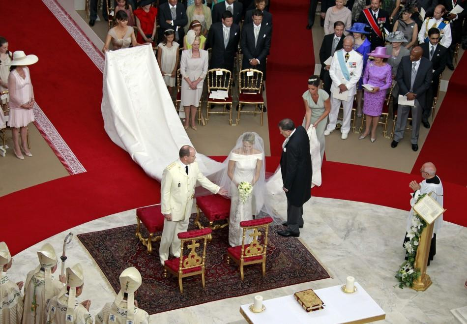 Monaco's Prince Albert II takes the hand of Princess Charlene during their religious wedding ceremony at the Palace in Monaco