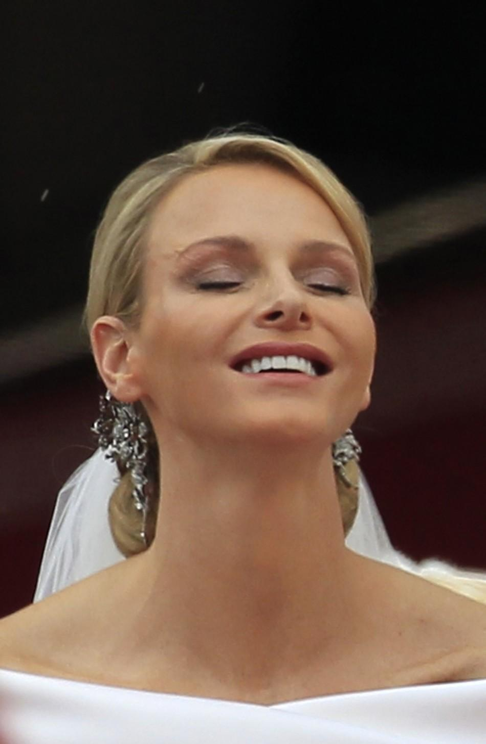 Monaco's Princess Charlene, wife of Prince Albert II smiles after the religious wedding ceremony in at the Palace in Monaco
