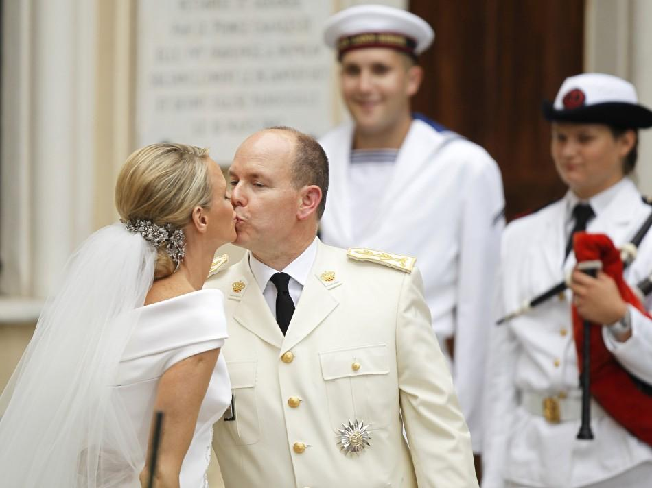 Princess Charlene and Monaco's Prince Albert II kiss outside the Sainte Devote church in Monaco after their religious wedding ceremony in Monaco