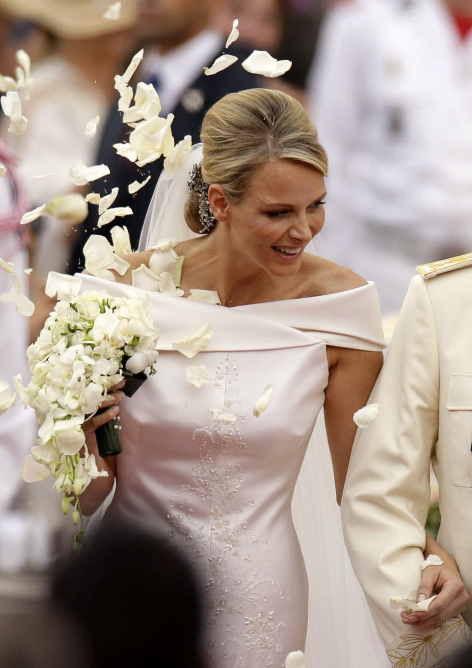 Princess Charlene of Monaco smiles as she departs from the Monaco palace after their religious wedding ceremony in Monaco