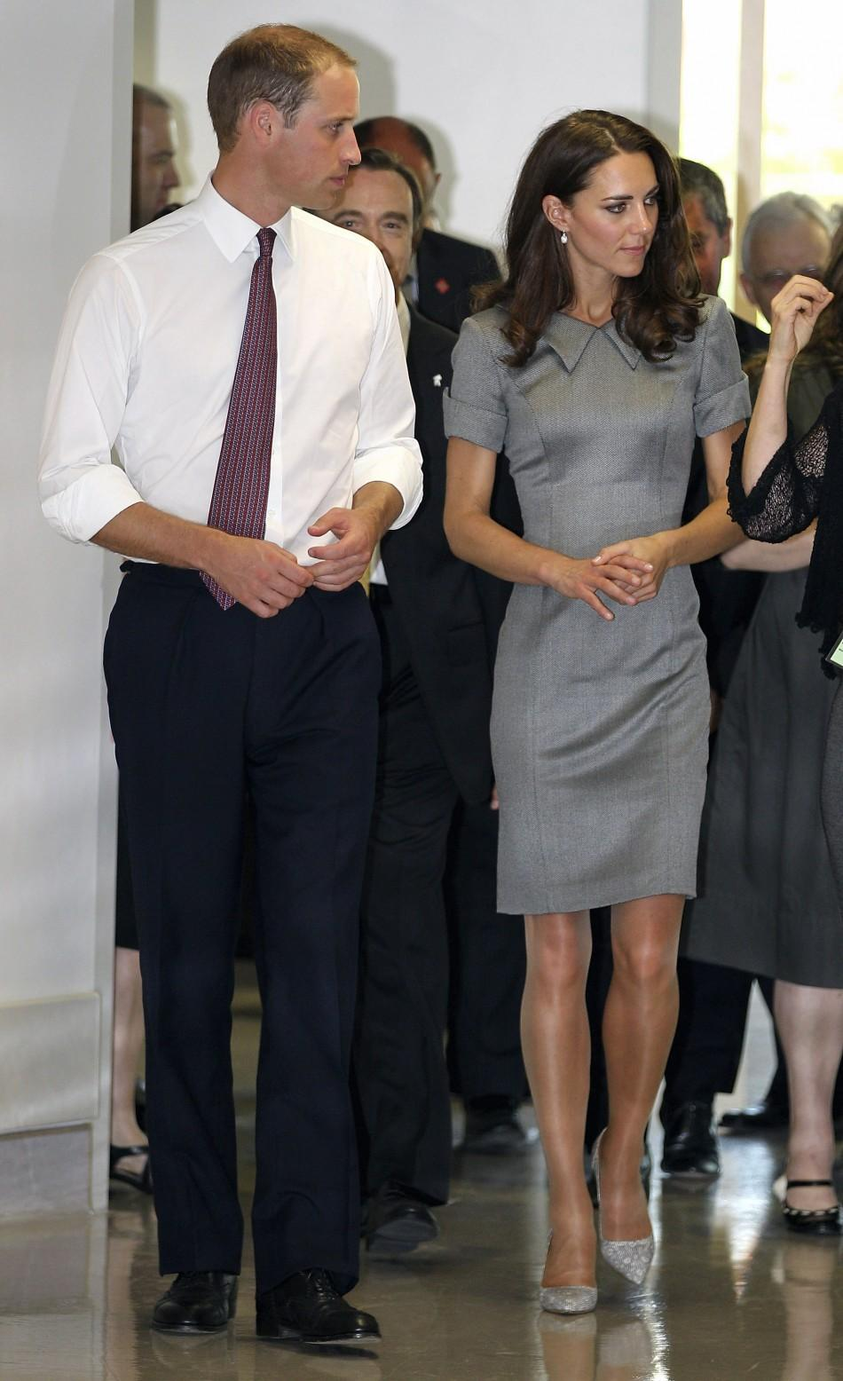 Prince William and Catherine, Duchess of Cambridge, walk as they visit the Sainte-Justine Hospital in Montreal