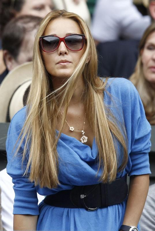 Jelena Ristic, the girlfiend of Novak Djokovic of Serbia, sits on Centre Court