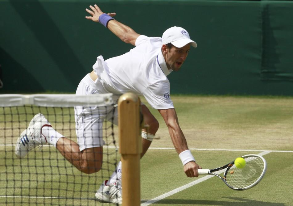 Novak Djokovic of Serbia hits a return to Rafael Nadal of Spain during their men's singles final match at the Wimbledon tennis championships in London.