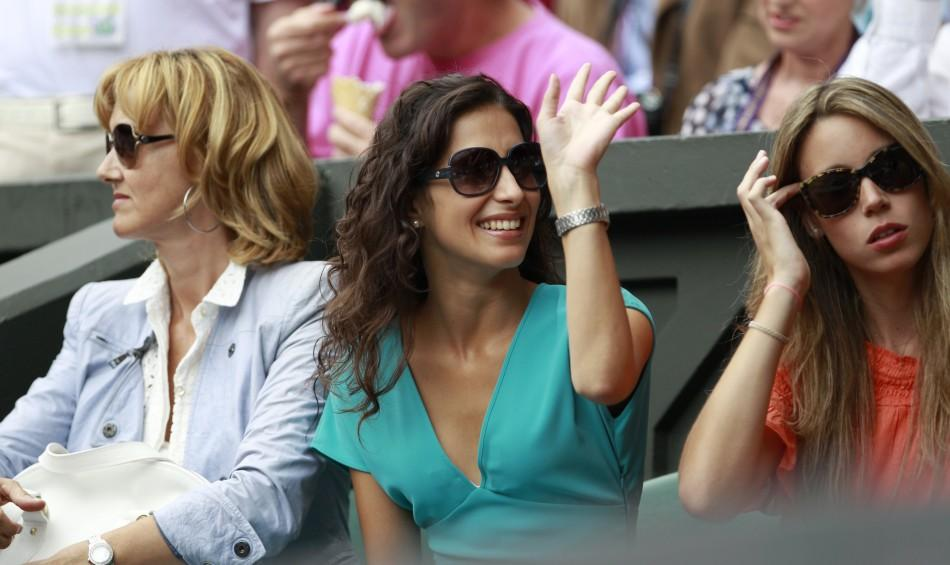 The mother of Rafael Nadal of Spain, his sister and his girlfriend sit on Centre Court for Nadal's match against Novak Djokovic of Serbia at the Wimbledon tennis championships in London