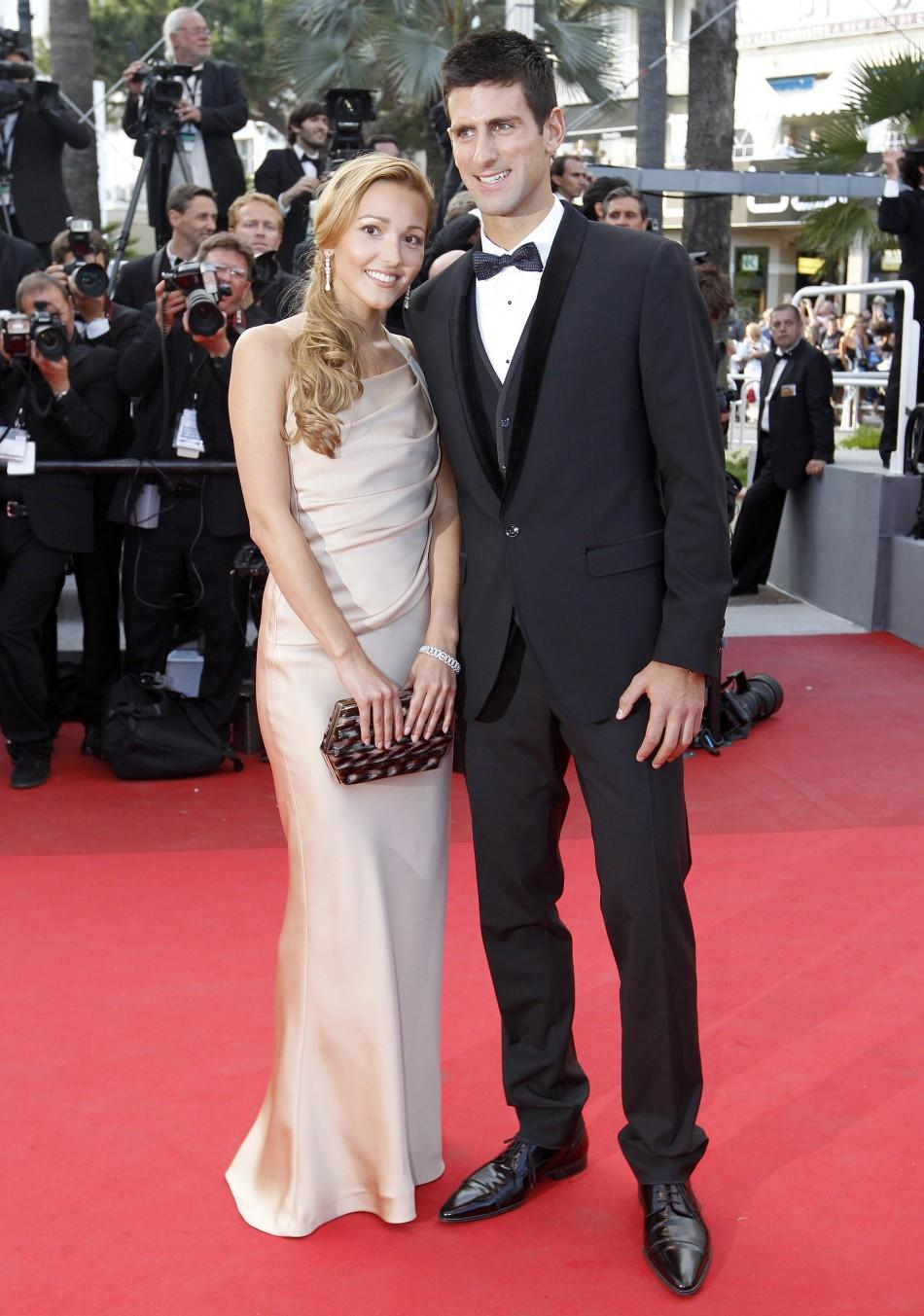 Tennis player Djokovic and girlfriend Ristic arrive on the red carpet for the screening of the film The Beaver at the 64th Cannes Film Festival
