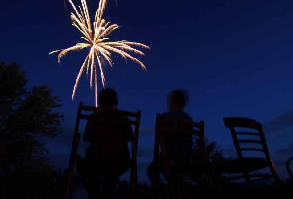 Boys watch the fireworks show at George Clausen's 4th of July party in Freedom, New Hampshire