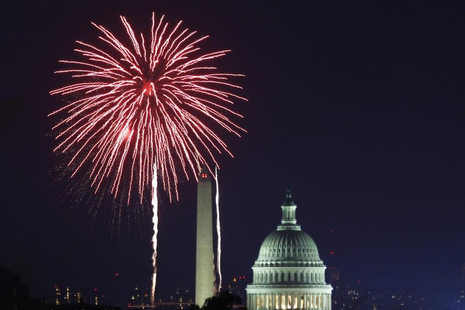 Fireworks light up the sky over the Potomac River near the Washington Monument as the U.S. celebrates its 235th Independence Day in Washington