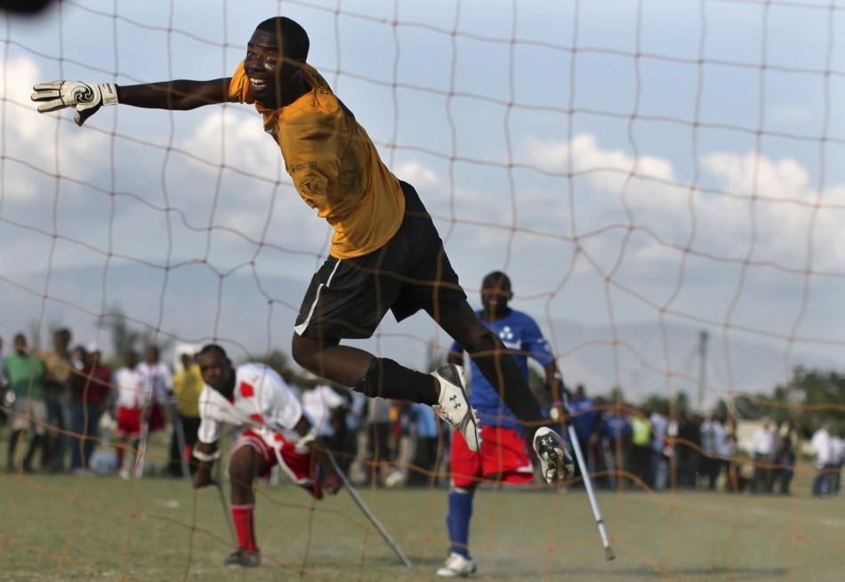 The Zaryen team goalkeeper jumps for the ball during a friendly match against Haiti's national amputee team in Port-au-Prince