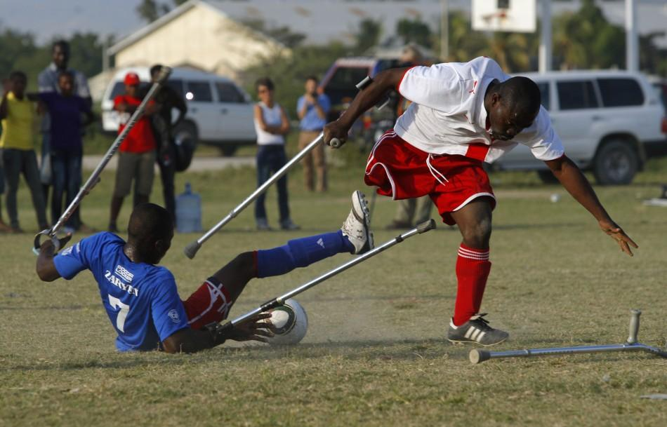 Soccer players of the Zaryen team (blue) and the national amputee team (white) fight for the ball during a friendly match in Port-au-Prince