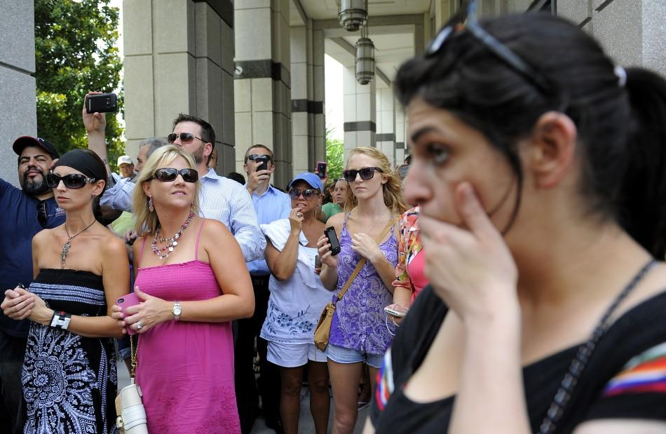 A crowd of spectators react moments after hearing the jury's verdict