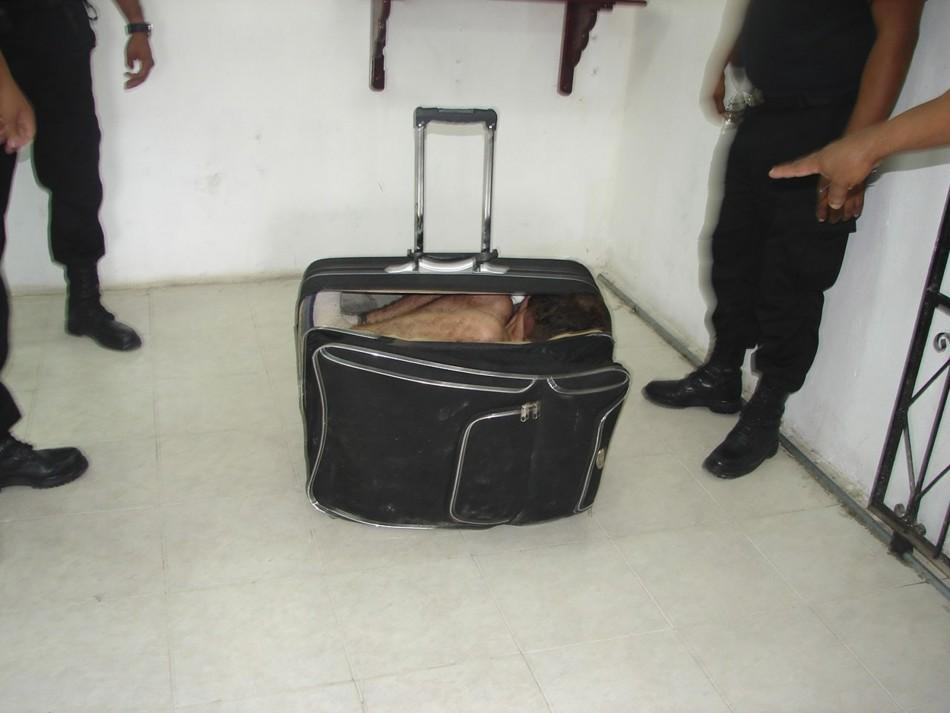 Startling visuals: Man caught for escaping prison in suitcase.