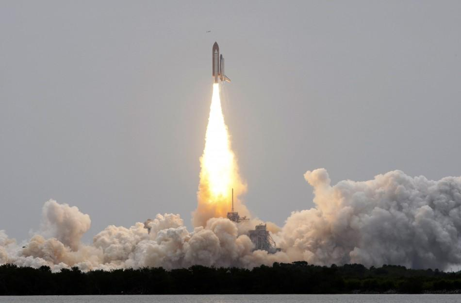 The space shuttle Atlantis, STS-135 lifts off from launch pad 39A at the Kennedy Space Center in Cape Canaveral