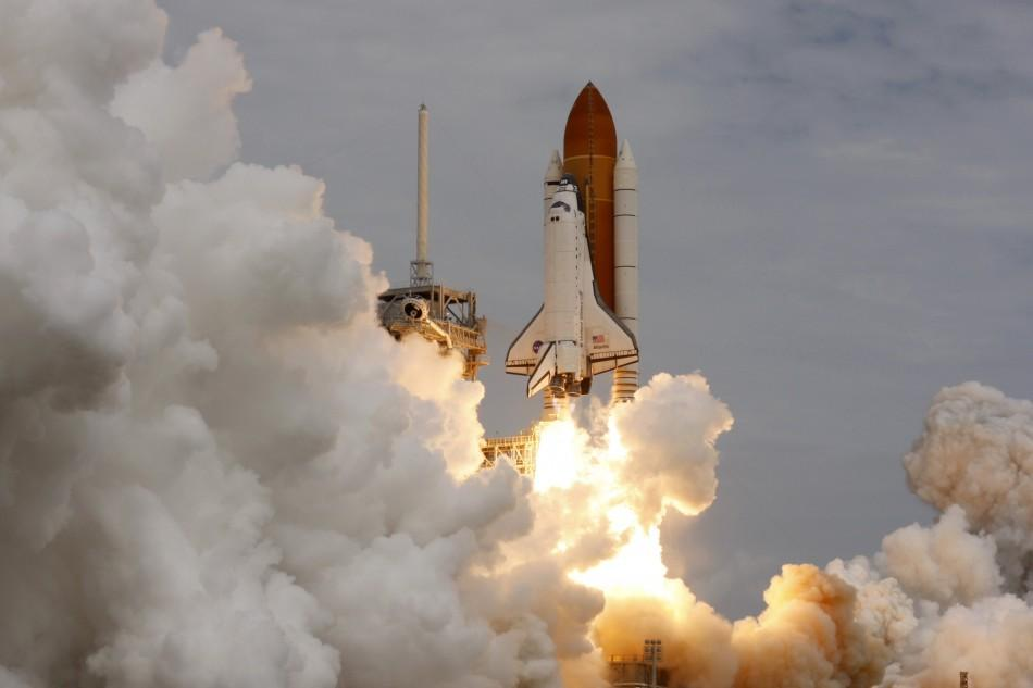 The space shuttle Atlantis STS-135 lifts off from launch pad 39A at the Kennedy Space Center in Cape Canaveral