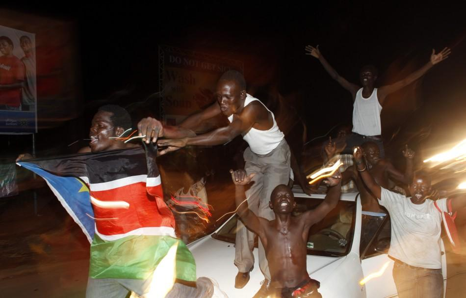 People dance on a car during South Sudan's independence day celebrations
