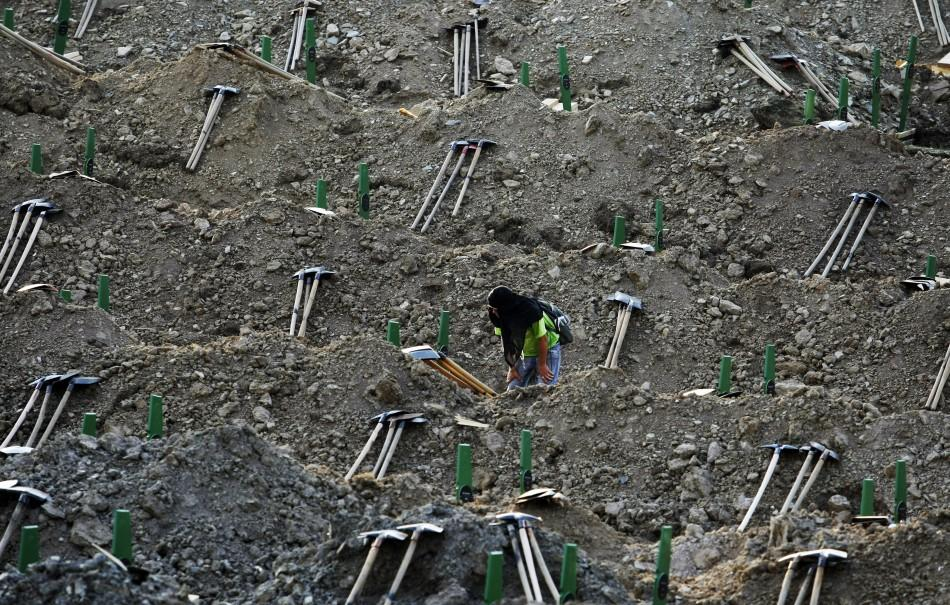A man looks at the graves prepared for a mass burial at the Memorial Center in Potocari, near Srebenica