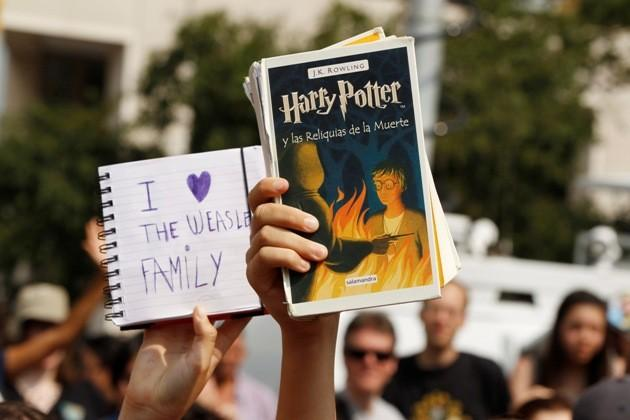 """Harry Potter fans hold up mementos at the premiere of the film """"Harry Potter and the Deathly Hallows: Part 2"""" in New York"""