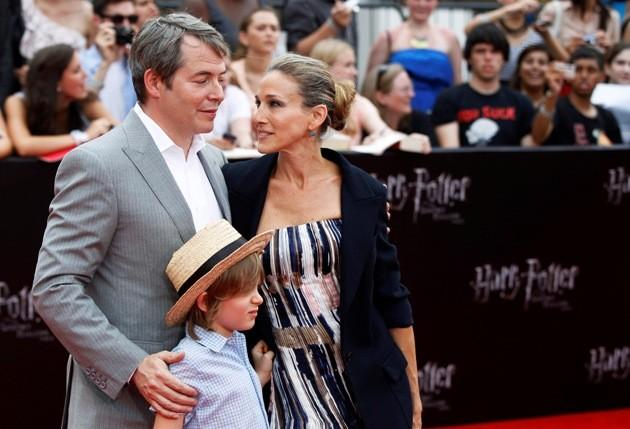"""Actress Jessica Parker and her husband, actor Broderick, arrive with their son for the premiere of the film """"Harry Potter and the Deathly Hallows: Part 2"""" in New York"""