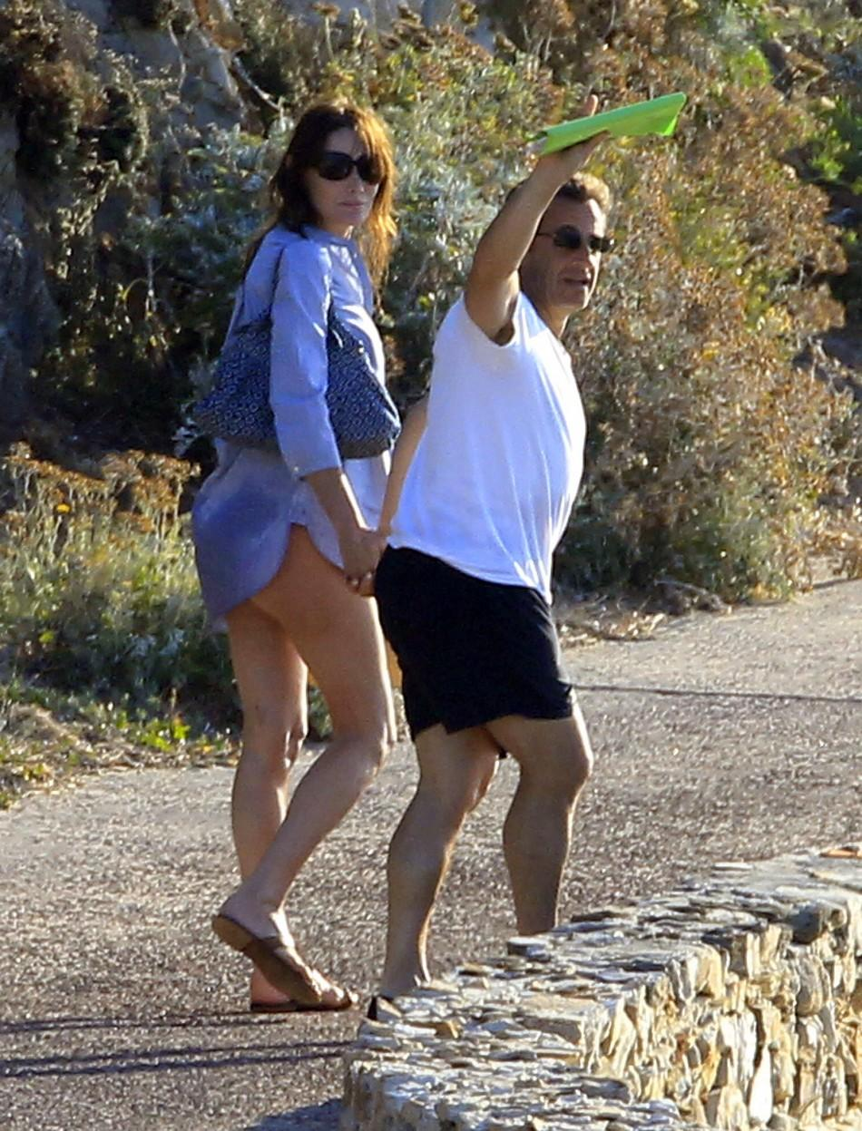 Holidaying Carla Bruni Reveals her Pregnant 'Rounded' Belly on the Beach