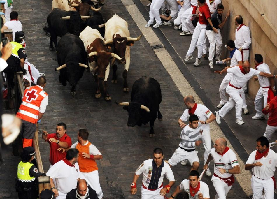 Victoriano del Rio fighting bulls run down Santo Domingo street during the sixth running of the bulls at the San Fermin festival in Pamplona.