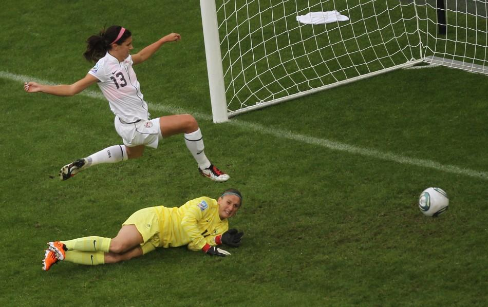 Morgan of the U.S. challenges France's goalkeeper Sapowicz during the Women's World Cup semi-final soccer match against France in Monchengladbach