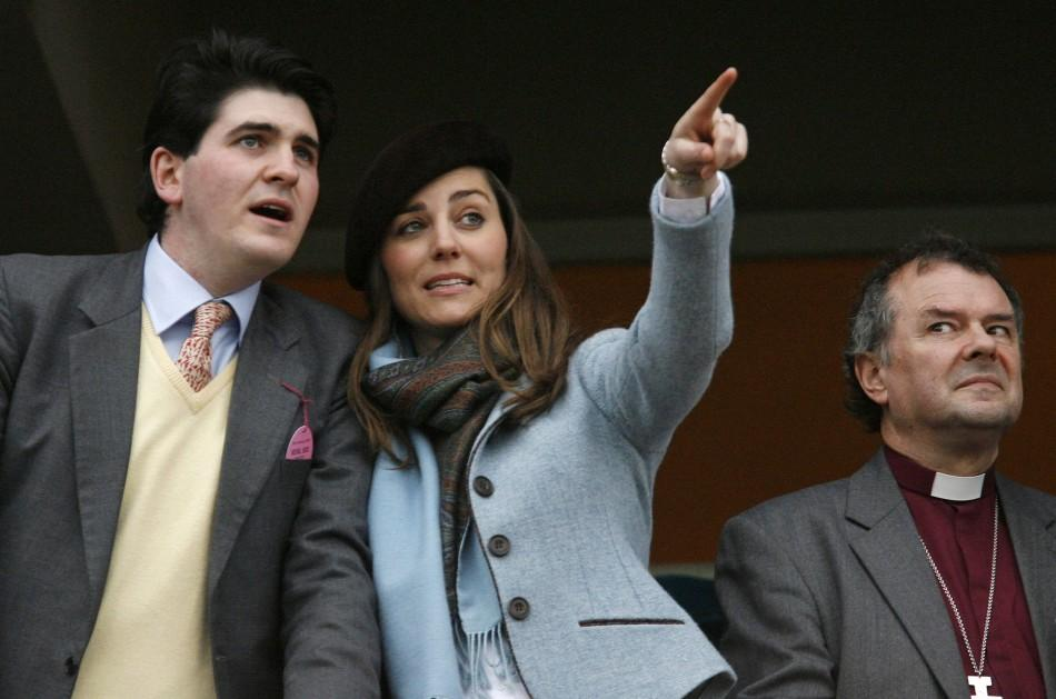 Middleton, girlfriend of Britain's Prince William, and unidentified friend react while watching on the final day of the Cheltenham Festival
