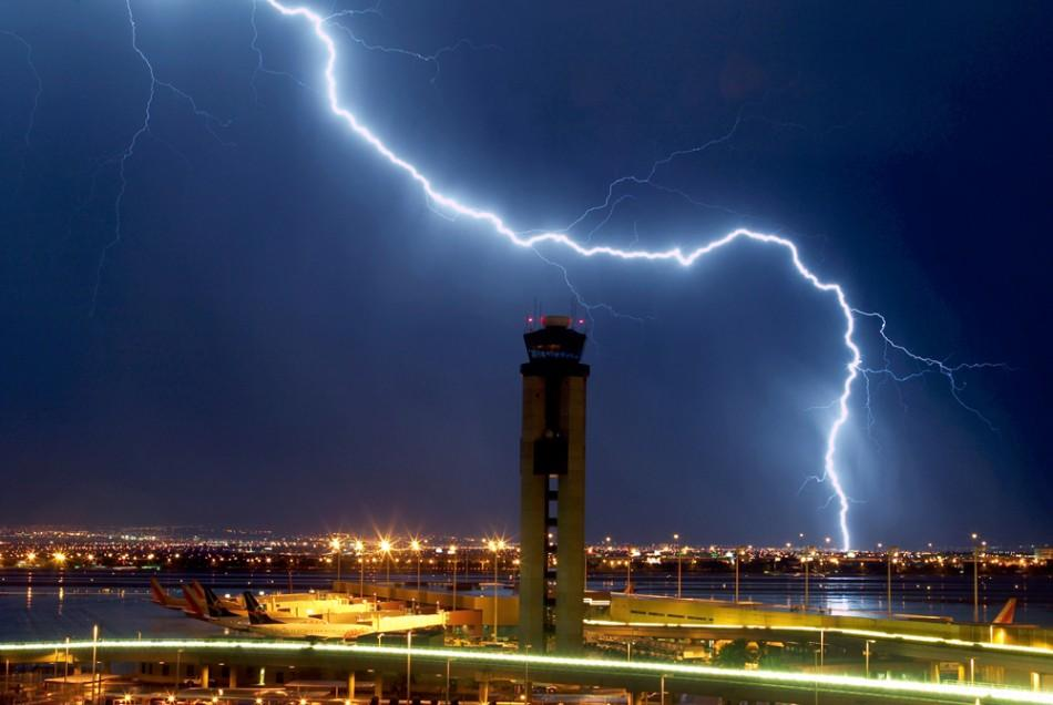 Lightning strikes just south of the McCarran International Airport air traffic control tower in Las Vegas
