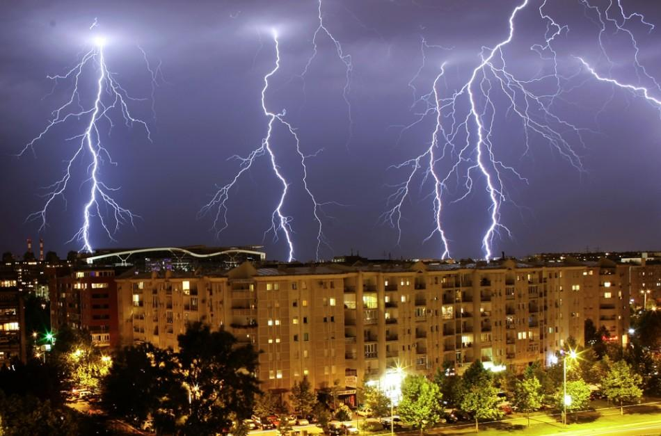 Lightning strikes over buildings during a thunderstorm in Belgrade