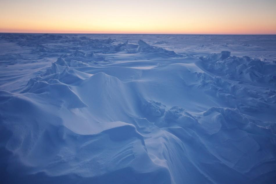 The sun sets over Arctic ice