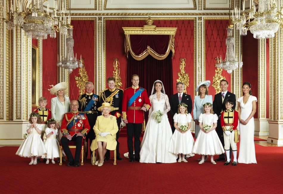 Britain's Prince William and his bride Kate Middleton, Duchess of Cambridge, pose for an official photograph, with their families, on the day of their wedding, in the throne room at Buckingham Palace, in central London