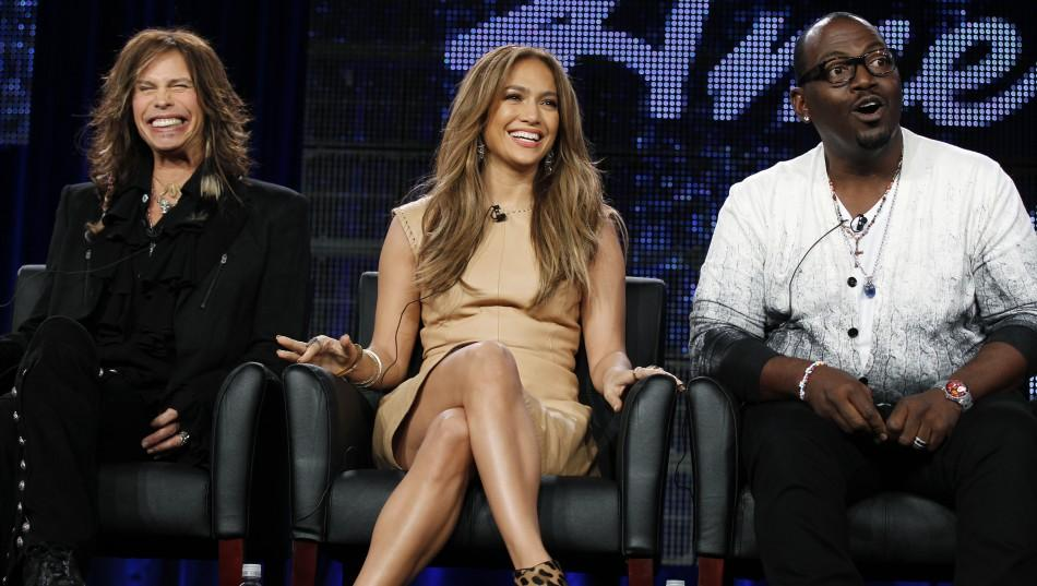 """Judges Steven Tyler (L), Jennifer Lopez (C) and Randy Jackson take part in a panel discussion for the show """"American Idol"""""""
