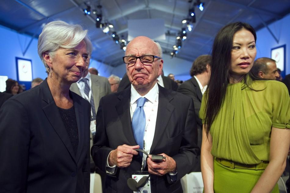 News Corporation CEO Murdoch, his wife Deng, and French Finance Minister Lagarde attend the eG8 forum in Paris