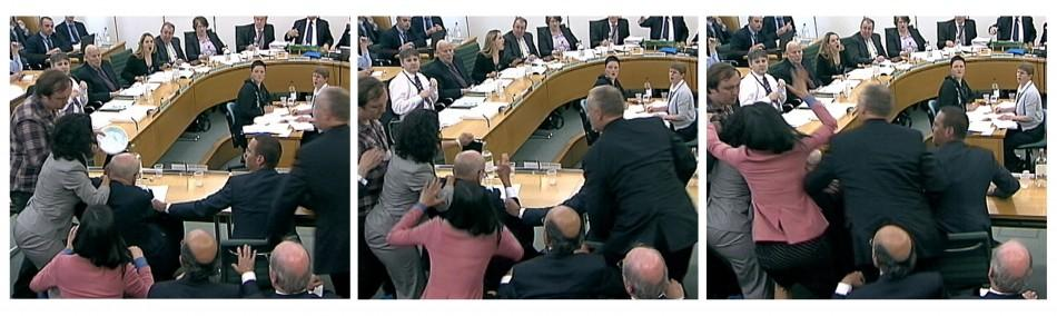 Wendi Deng unges towards a man trying to attack her husband, News Corp Chief Executive and Chairman Rupert Murdoch, during a parliamentary committee hearing on phone hacking at Portcullis House in London