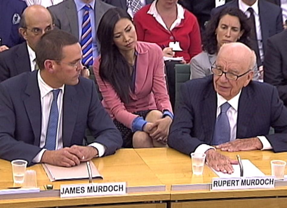 James and Rupert Murdoch appear before a parliamentary committee at Portcullis House in London