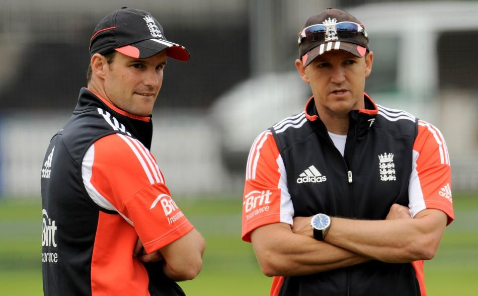 England's Strauss and Flower talk during a training session before Thursday's first cricket test match against India at Lord's.
