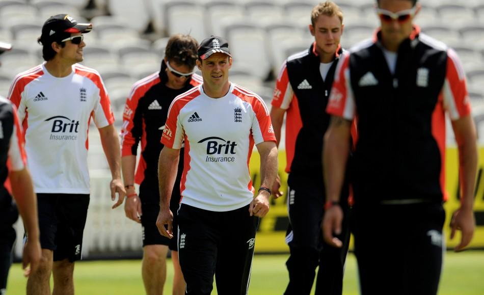 England's Strauss walks with other players during a training session before Thursday's first cricket test match against India at Lord's cricket ground in London.