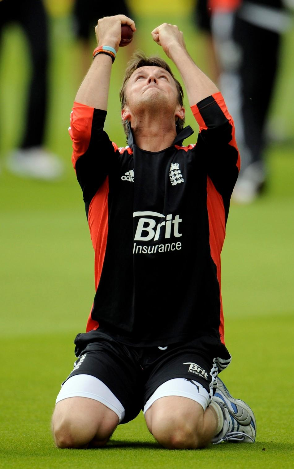 England's Swann reacts after taking a catch during a training session before Thursday's first cricket test match against India at Lord's cricket ground in London.