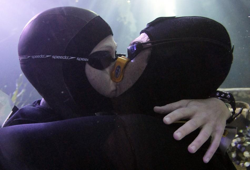 Free divers Maric and Bonin kiss to set the new world record for the longest underwater kiss, in an oceanic tank at the Gardaland Sea Life Aquarium in Castelnuovo del Garda