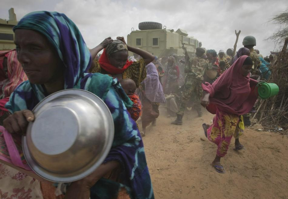 Women rush into a feeding centre in a camp established by the Somali Transitional Federal Government for the internally displaced people in Mogadishu