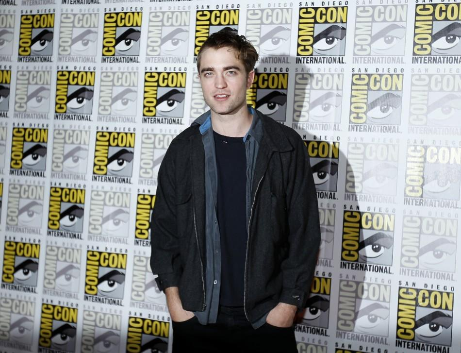 "Robert Pattinson poses to promote ""Breaking Dawn"" from the Twilight Saga at Comic Con in San Diego"
