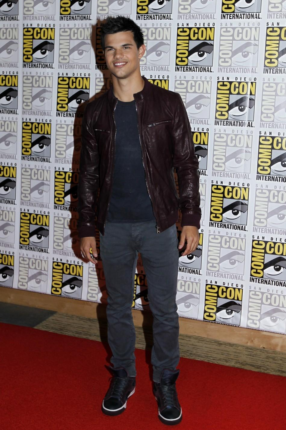 "Taylor Lautner poses to promote ""Breaking Dawn"" from the Twilight Saga at Comic Con in San Diego"