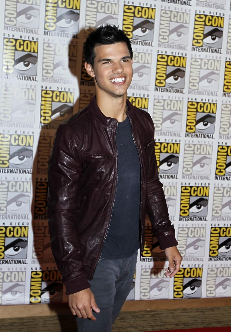 "Actor Taylor Lautner poses to promote ""Breaking Dawn"" from the Twilight Saga at Comic Con in San Diego, California"