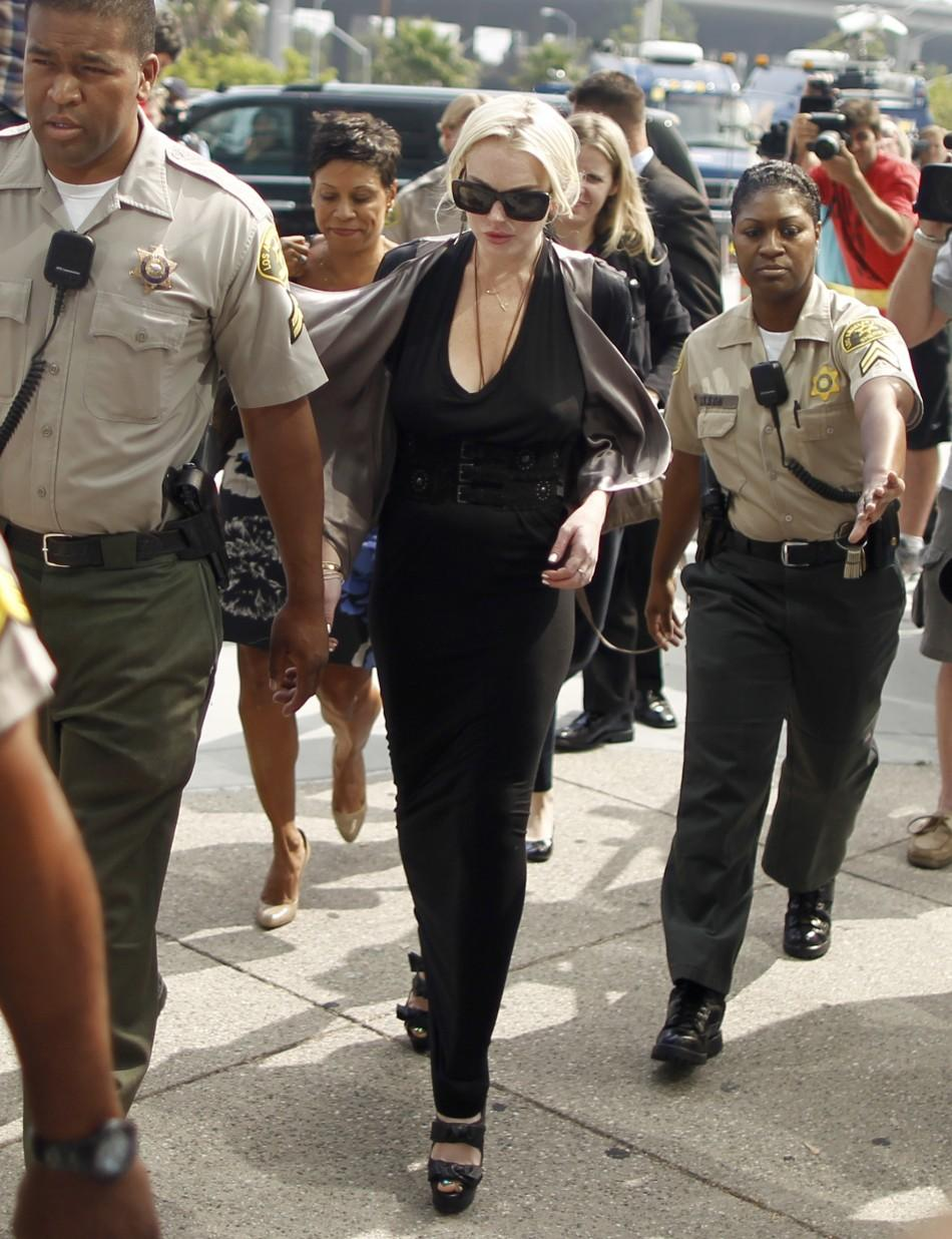 Actress Lindsay Lohan arrives in court for a compliance check to report her progress on 480 hours of community service she must do for shoplifting a necklace from a Venice jeweler, in Los Angeles