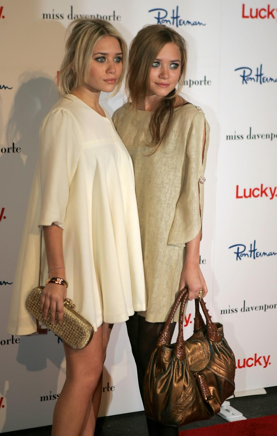 Ashley and Mary Kate Olsen arrive at the Miss Davenporte trunk show in Hollywood